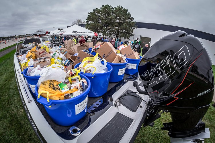 Mercury Marine raises nearly $11,000 during its annual Fill the Boat to Cast Out Hunger food drive
